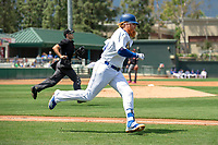 Los Angeles Dodger Justin Turner (31) on rehab assignment playing for the Rancho Cucamonga Quakes hustles down the first base line against the Visalia Rawhide at LoanMart Field on May 13, 2018 in Rancho Cucamonga, California. The Quakes defeated the Rawhide 3-2.  (Donn Parris/Four Seam Images)