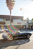 USA, Los Angeles, a car driving down the road along Abbot Kinney Boulevard