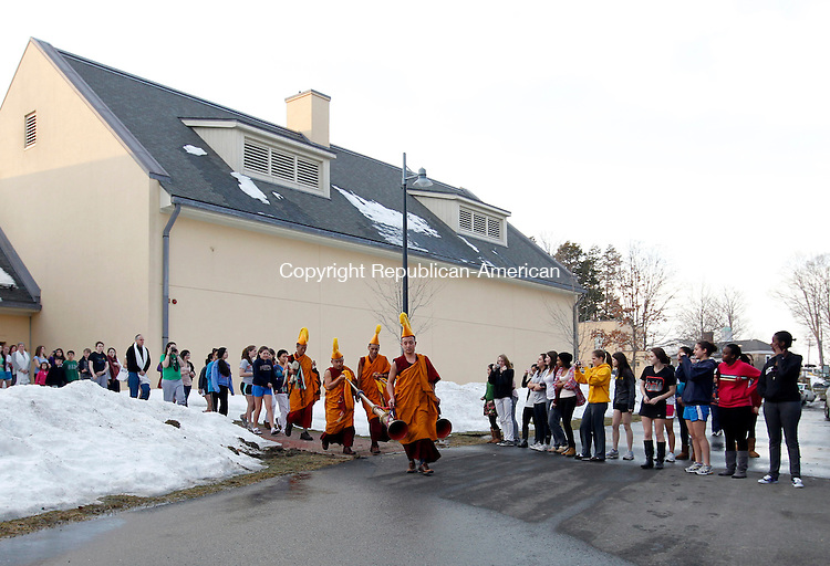 Middlebury, CT- 18, February 2011-021811CM02  Tibetan Monks lead a processional at the Westover School in Middlebury Friday afternoon.  The Monks finished the sand mandala which they were working on all week.  After sweeping up the sand, the Monks dispersed it into a river on campus, which is said to bring the campus good luck.  Christopher Massa Republican-American