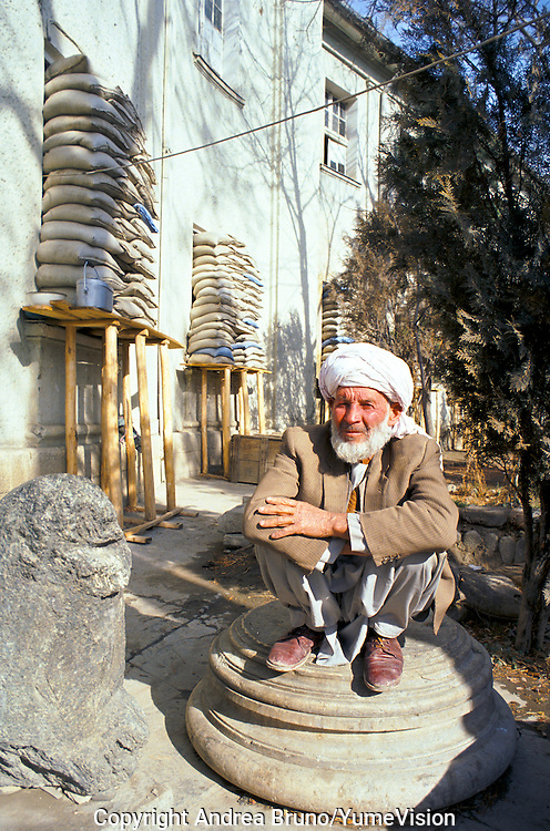 The Tchauki Door (house keeper) at the National Museum in 1990. Protect by send bag's the museum was still intact. Kabul, Afghanistan