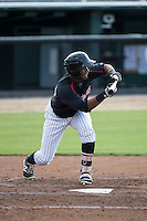 Louis Silverio (25) of the Kannapolis Intimidators squares to bunt against the Lakewood BlueClaws at Intimidators Stadium on July 16, 2015 in Kannapolis, North Carolina.  The BlueClaws defeated the Intimidators 3-1.  (Brian Westerholt/Four Seam Images)