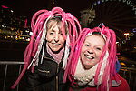 © Joel Goodman - 07973 332324 . 31/12/2013 . Manchester , UK . Denise Greaves (53 from Sale Moor) and Stacie Pugh (26 - Denise's son's partner - also from Sale Moor) (both correct) . Revellers gather in Piccadilly Gardens ahead of the New Years fireworks display to usher in 2014 . Photo credit : Joel Goodman