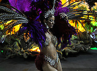 A dancer of Vila Isabel samba school performs during parade at the Sambadrome, Rio de Janeiro, Brazil, March 3, 2014.  (Austral Foto/Renzo Gostoli)