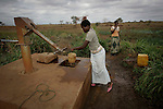 World Water Day. Two girls of Macue comunity are drawing water from the well, which is located in a central point to serve several villages, approximately to one or two kilometers of each one.