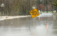 Floodwaters of Osage Creek flow Thursday, March 19, 2020, over South Rainbow Road near the intersection with West Northgate Road in Rogers. The section of road usually becomes impassable after heavy rain. The National Weather Service issued a flash flood warning and tornado watch Thursday for Northwest Arkansas. Check out nwaonline.com/200320Daily/ for today's photo gallery.<br /> (NWA Democrat-Gazette/Ben Goff)