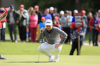 Tyrrell Hatton (ENG) lines up his putt on the 16th green during Sunday's Final Round of the 2017 Omega European Masters held at Golf Club Crans-Sur-Sierre, Crans Montana, Switzerland. 10th September 2017.<br /> Picture: Eoin Clarke | Golffile<br /> <br /> <br /> All photos usage must carry mandatory copyright credit (&copy; Golffile | Eoin Clarke)