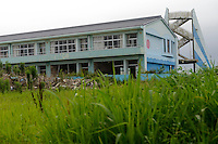 An elementary school abandoned in the evacuation of Namie, Fukushima Prefecture, Japan, August 2, 2013. The town of Namie was evacuated following the nuclear accident of March 2011. Residents can only return for short periods to tend to their former homes and pick up belongings, and are not permitted to stay overnight.