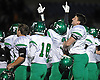 Farmingdale teammates celebrate after their 34-23 win over Oceanside in the Nassau County varsity football Conference I final at Hofstra University on Saturday, Nov. 21, 2015.<br /> <br /> James Escher