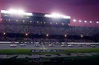 Cars race down the frontstretch  during the  Pepsi 400 at Daytona International Speedway in July 2000.(Photo by Brian Cleary)