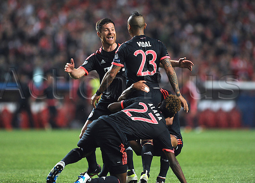 13.04.2016. Lisbon, Portugal.  Munich's Arturo Vidal (top R) celebrates with teammate Xabi Alonso (L) after scoring the equalizing goal during the UEFA Champions League quarterfinal second leg soccer match between SL Benfica and FC Bayern Munich at Estadio da Luz in Lisbon, Portugal, 13 April 2016.