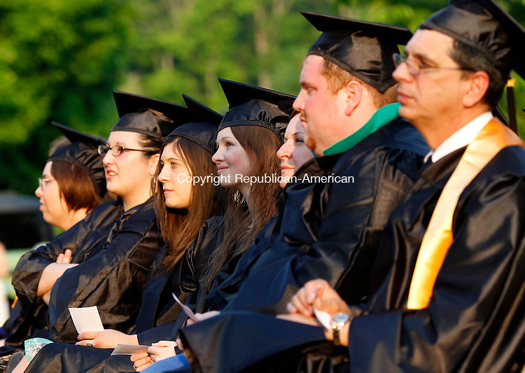 Winsted, CT- 26, May 2011-052611CM13 Graduates listen to commencement speakers during the Northwest Community College graduation Thursday night at East End Park in Winsted.  Christopher Massa Republican-American