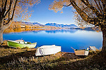 Under autumn willows three boats await their skippers for a day of leisure on the picturesque Lake Alexandrina..This New Zealand Fine Art Landscape Print, available in four sizes on either archival Hahnemuhle Fine Art Pearl paper or canvas, is printed using Epson K3 Ultrachrome inks and comes with a lifetime guarantee against fading..All prints are signed and numbered on the lower margin and come with my 100% money back guarantee on the purchase price, should you not be  completely happy with the quality of the delivered print or canvas.