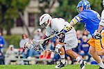 Los Angeles, CA 04/02/10 - Michael Hanover (LMU #25) and Oisin Lewis (UCSB #2) in action during the UCSB-LMU MCLA SLC conference lacrosse game at Loyola Marymount University.