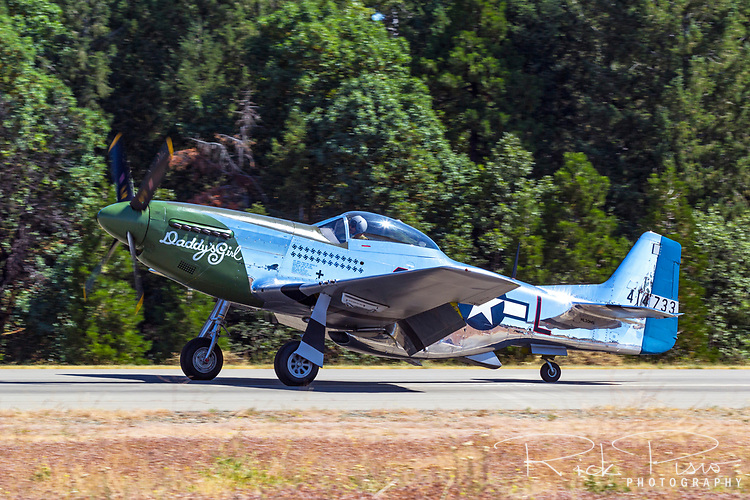 "P-51D Mustang 44-63807 (N20MS) ""Daddy's Girl"" taxies on the Grass Valley runway after arrival."