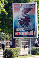 "Anti U.S. propoganda posters in Pyongyang, North Korea. The DPRK (Democratic People's Republic of Korea) is the last great dictatorship where the people are bombarded with images of the ""Eternal President"" Kim Il-sung who died in 1994  and his son and current leader Kim Jong-il who are worshipped like a God.."