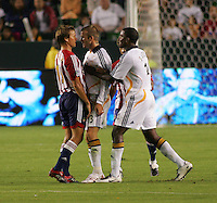 LA Galaxy midfielder David Beckham (23) almost go to blows with Chivas midfielder Jessie Marsch (15) while Galaxy forward Edson Buddle (14) tries to seperate them. CD Chivas USA defeated the LA Galaxy 3-0 in the Super Classico MLS match at the Home Depot Center in Carson, California, Thursday, August 23, 2007.