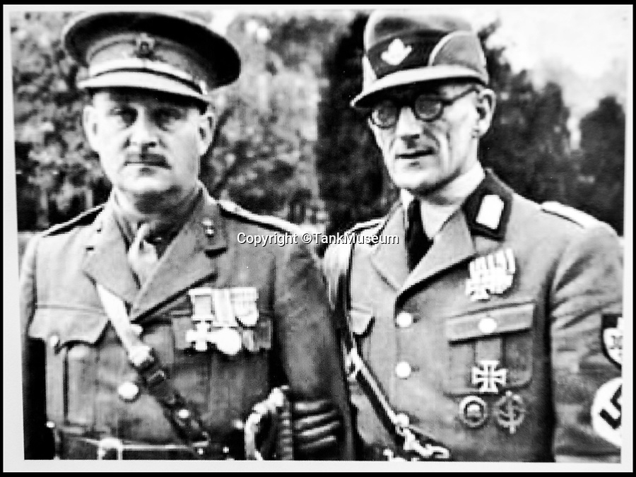 BNPS.co.uk (01202 558833)<br /> Pic: TankMuseum/BNPS<br /> <br /> Capt Clement Arnold reunited with Ritter Ernst von Maravic in 1936.<br /> <br /> Moving and miraculous survivor from 100 years ago - fragile timepiece reveals a remarkable story of courage, death and unlikely friendship from the Western Front.<br /> <br /> An unlikely friendship between a British World War One tank commander and the German foe who saved his life has come to light 100 years after they first met on the battlefield.<br /> <br /> Lieutenant Clement Arnold, of the Tank Corps, had been in charge of a Whippet tank which ploughed through the German defences and wreaked havoc on their trenches at the Battle of Amiens on the 8/8/1918, before recieving a direct hit and catching fire, forcing the three man crew to bail out.<br /> <br /> The enraged German soldiers bayoneted to death the tank driver, Private W J Carnie, but before Lt Arnold suffered the same fate, German officer Ritter Ernst von Maravic stepped in and ordered that he and the tank's gunner were taken prisoner instead.<br /> <br /> As a gesture of gratitude, Lt Arnold gave von Maravic the prized  wristwatch given to him by his father, his most valuable possession.<br /> <br /> Amazingly the two foes then made contact and became friends in the 1930's when von Maravic returned the watch to Clement Arnold and even holidayed in Llandudno with the Arnold family. <br /> <br /> Yesterday Lt Arnold's nephew Jolyon(83) visited the Tank Museum museum in Dorset to retell the astonishing story.