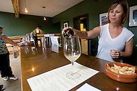 erath  160436 8/30/09-  Kelly Bostock (CQ) pours wine in the Dos Cabezas tasting room. (Pat Shannahan/ The Arizona Republic)