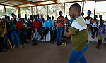Frido Kinkolenge is coordinator of children's ministries for the United Methodist Church in Liberia. Here he speaks to participants at the Brighter Future Children Rescue Center in Buchanan. The center carries out rehabilitation work with ex-combatants and other war-affected children.