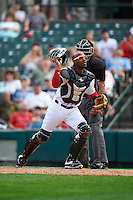 Rochester Red Wings catcher Carlos Paulino (17) looks for the ball in front of umpire Roberto Ortiz during a game against the Columbus Clippers on June 16, 2016 at Frontier Field in Rochester, New York.  Rochester defeated Columbus 6-2.  (Mike Janes/Four Seam Images)