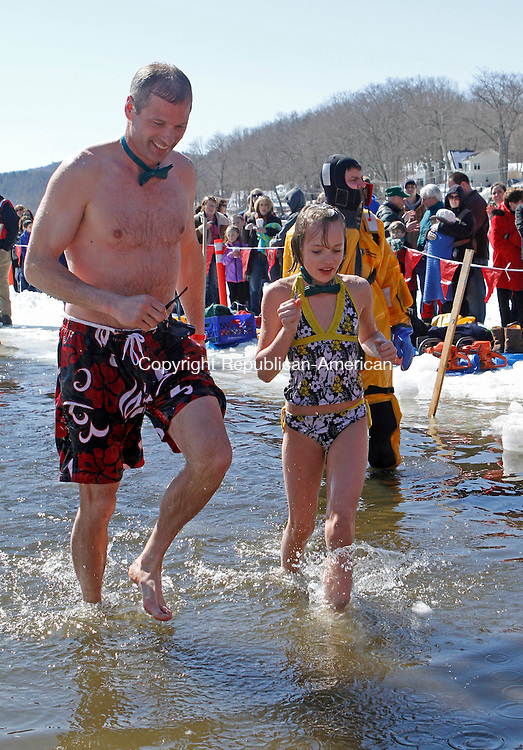 Winsted, CT-030913MK24 Tom Weik and his daughter Lexi, from Morris, run out of the the thirty-two degree water in Highland Lake during the annual Penguin Plunge on Saturday afternoon in Winsted. Sharon Pelkey, director of development northwest region, said that there were one-hundred forty-eight jumpers and the event raised over $54,500 for the Special Olympics. Michael Kabelka Republican American