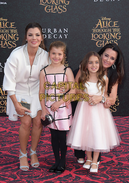 Kyle Richards and Portia Umansky, Estela Ines Monteverde and Ali Landry attends The Premiere Of Disney's &quot;Alice Through The Looking Glass&quot; held at The El Capitan Theatre  in Hollywood, California on May 23,2016                                                                                <br /> CAP/DVS<br /> &copy;DVS/Capital Pictures