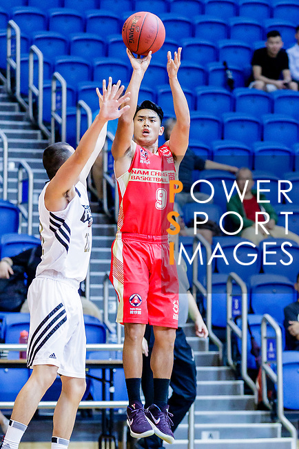 Ho Yee Fu #9 of Nam Ching Basketball Team tries to score against the Eagle during the Hong Kong Basketball League game between Eagle and Nam Ching at Southorn Stadium on June 22, 2018 in Hong Kong. Photo by Yu Chun Christopher Wong / Power Sport Images