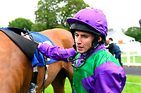Ryan Moore unsaddles Tapisserie in the Winners Enclosure after winning The Wilton Homes Novice Stakes during Evening Racing at Salisbury Racecourse on 11th June 2019