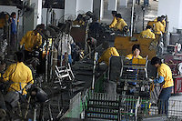 Men and women on production line in a privately owned metal works factory, producing parts for major foreign companies including Fuji Xerox, Panasonic, Black & Decker and DeWalt, both for Chinese market and for export (including UK , US and Japan).