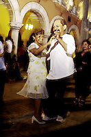 a couple enjoy dancing to the music of the Sonora Santanera on a Sunday evening in Merida's Plaza Grande.