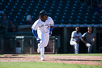 Surprise Saguaros third baseman Vladimir Guerrero Jr. (27), of the Toronto Blue Jays organization, starts down the first base line during an Arizona Fall League game against the Salt River Rafters on October 9, 2018 at Surprise Stadium in Surprise, Arizona. The Rafters defeated the Saguaros 10-8. (Zachary Lucy/Four Seam Images)