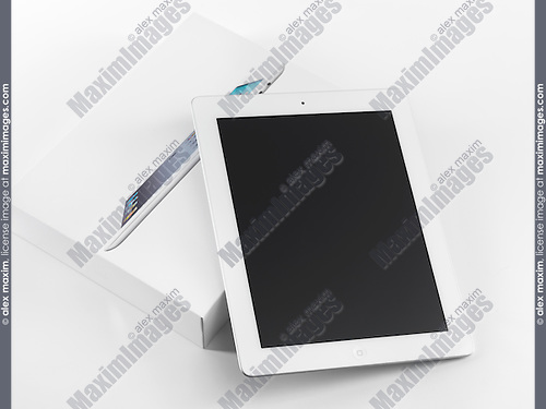New Apple iPad 2 just out of the box. Isolated on white background.