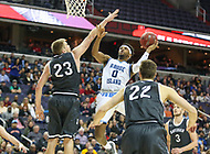 Washington, DC - March 11, 2018: Rhode Island Rams guard E.C. Matthews (0) avoids the block from Davidson Wildcats forward Peyton Aldridge (23) during the Atlantic 10 championship game between Rhode Island and Davidson at  Capital One Arena in Washington, DC.   (Photo by Elliott Brown/Media Images International)