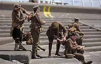 Men in World War I gear have lunch by Aberavon beach, Port Talbot, south Wales UK. Friday 01 July 2016