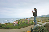 Hudson McCarty performed on his guitar and harmonica for visitors to the Pescadero State Beach, California, on Labor Day 2006, hoping to gather some dimes and quarters, and maybe even some folding money to put gas in his tank  so he could continue his journey, probably north.