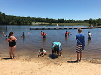 People enjoy a lake front public beach.. Photo/Andrew Shurtleff Photography, LLC