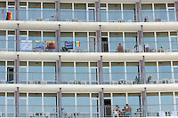 Sunny Beach, Nesebar, Bulgaria..Holidaymakers on the balconies of one of the giant hotel complexes lining Sunny Beach, the largest holiday resort in the Balkans, and a popular destination for cheap foreign package tours.