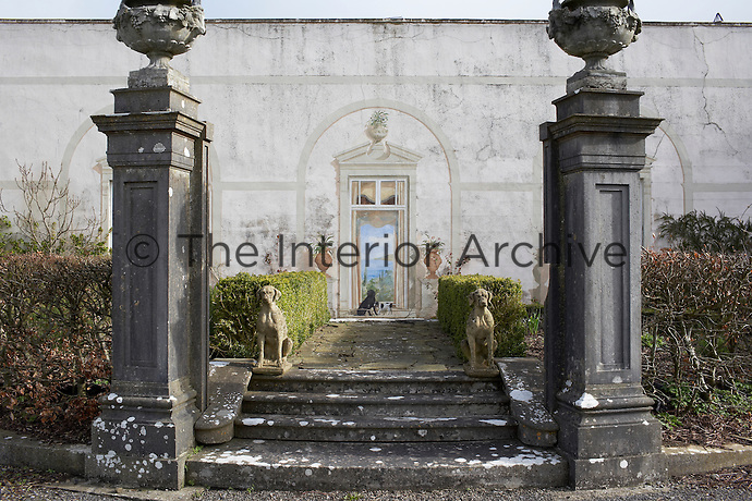 Two pillars and steps, the remains of an original house, lead up to a trompe l'oeil window, Loughcrew House, County Meath, Ireland