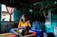 JAIPALGURI, INDIA- AUGUST 16: Player and coach of the female football team, the Dooars XI,  Bhabani Munda, 24, holds her most prized trophies as she poses for a portrait on August 16, 2013 at the Kalchini tea estate In Jalpaiguri district , West Bengal, India. The Kalchini tea estate where Bhabani Munda lives is one of the most interior and backwards regions in north Bengal. The tea estates of North Bengal, including the Kalchini tea estate, were in news in 2007-08 for large-scale starvation deaths owing to malnutrition. Even today one person dies every day due to starvation in the north Bengal tea estates. In the last decade there have been 3500 deaths in these tea estates. (Photo by Daniel Berehulak for Time Magazine)