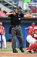 Home plate umpire Chris Graham makes a call during a game between the Auburn Doubledays and Batavia Muckdogs on June 16, 2014 at Dwyer Stadium in Batavia, New York.  Batavia defeated Auburn 4-3.  (Mike Janes/Four Seam Images)