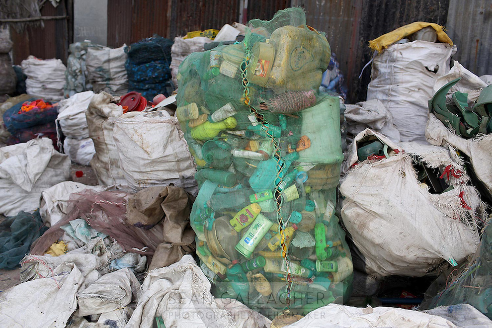 Piles of plastic sit in a informal recycling centre in Kolkata.<br /> <br /> To license this image, please contact the National Geographic Creative Collection:<br /> <br /> Image ID: 1925741<br />  <br /> Email: natgeocreative@ngs.org<br /> <br /> Telephone: 202 857 7537 / Toll Free 800 434 2244<br /> <br /> National Geographic Creative<br /> 1145 17th St NW, Washington DC 20036