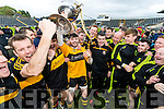 Dr Crokes players celebrate with the Bishop Moynihan Cup after defeating Kenmare District in the Senior County Football Championship final at Fitzgerald Stadium on Sunday.