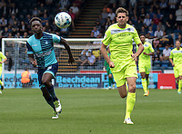 Chris Porter of Colchester United case the ball with Anthony Stewart of Wycombe Wanderers during the Sky Bet League 2 match between Wycombe Wanderers and Colchester United at Adams Park, High Wycombe, England on 27 August 2016. Photo by Liam McAvoy.