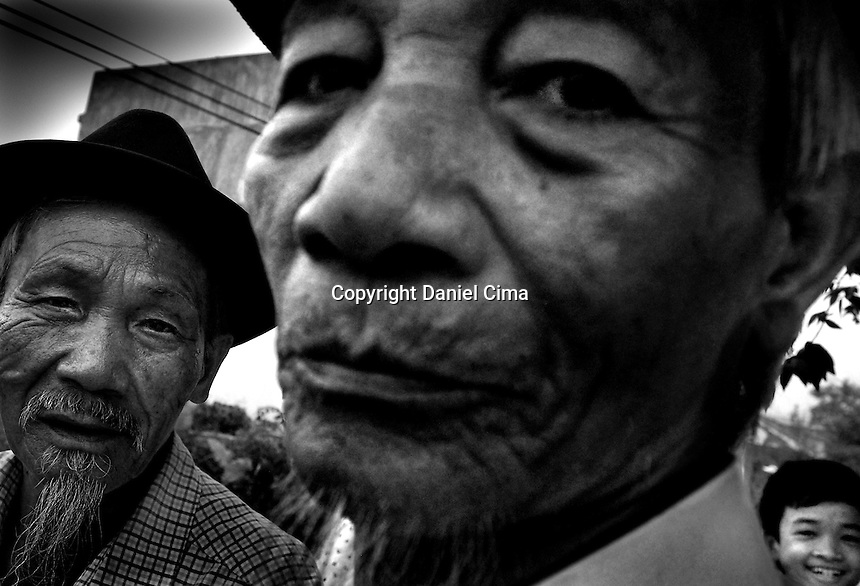 Portrait of men (typhoon surviver) at home in .Da-Nang, The Socialist Republic of Vietnam. May 2007