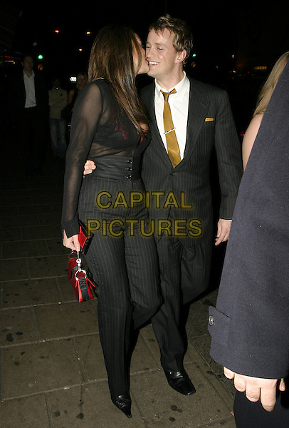 """JODI ALBERT & KIAN EAGAN (OF WESTLIFE).""""Beyond the Sea"""" UK Premiere, .Vue Cinema, Leicester Square, .London, 25 November 2004..full length couple matching outfits clothes pinstripe suits couple kissing.Ref: AH.www.capitalpictures.com.sales@capitalpictures.com.©Capital Pictures."""