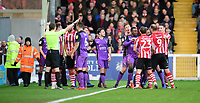 Tempers threaten to boil over towards the end of the first half<br /> <br /> Photographer Chris Vaughan/CameraSport<br /> <br /> The EFL Sky Bet League Two - Lincoln City v Port Vale - Tuesday 1st January 2019 - Sincil Bank - Lincoln<br /> <br /> World Copyright &copy; 2019 CameraSport. All rights reserved. 43 Linden Ave. Countesthorpe. Leicester. England. LE8 5PG - Tel: +44 (0) 116 277 4147 - admin@camerasport.com - www.camerasport.com