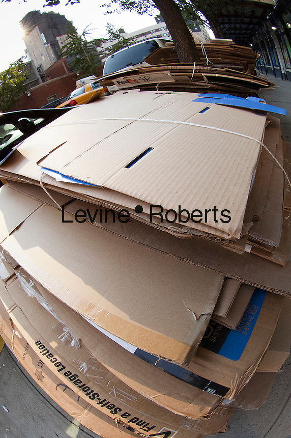 Cardboard in residential trash bundled for pick up and recycling on Thursday, September 13, 2012. (© Richard B. Levine)