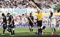 Pictured: Match referee Lee Mason (yellow) shows Sascha Rietner of Fulham (7) a yellow card for his foul against Ben Davies who is on the ground. Sunday 19 May 2013<br />