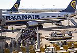 Passengers held back people waiting to board a Ryanair plane flight Faro airport, Portugal