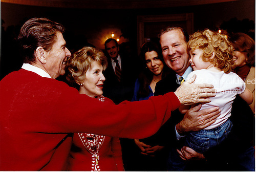 United States President Ronald Reagan and first lady Nancy Reagan meet Mary Bonner Baker, daughter of White House Chief of Staff James A. Baker, III at the White House in Washington, D.C. on Saturday, April 11, 1981.Mandatory Credit: Bill Fitz-Patrick - White House via CNP